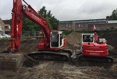 Leerling en ervaren machinist grondverzetmachines